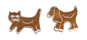 Cute Christmas gingerbreads in cat and dog shape. Two sweet fragrant candies decorated by icing. Traditional homemade confections. Idea of Xmas, Children`s day Stock Image