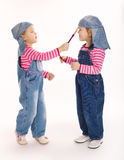 Two sweet little twins painters Royalty Free Stock Photo