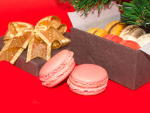Two sweet macarons against Gift box Royalty Free Stock Photos