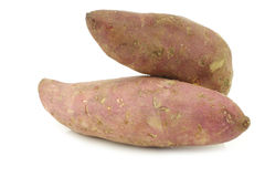 Two sweet potatoes Stock Photos