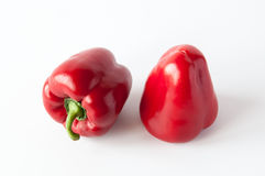 Two sweet red peppers Stock Images