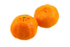 Two sweet ripe spain mandarins. On the white Royalty Free Stock Photo
