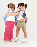 Two sweet school girls. Two school girls posing with attitude Royalty Free Stock Photo