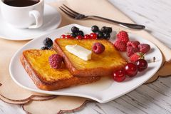 Two sweet toast with honey and berries close-up. Horizontal Royalty Free Stock Photo