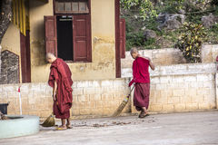 Two sweping monks Royalty Free Stock Photography