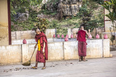 Two sweping monks Royalty Free Stock Photo