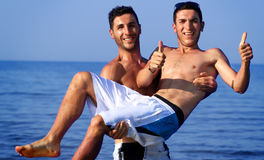 Two swimers have fun Stock Images