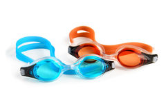 Two Swimming Goggles on White. Blue and orange swimming goggles isolated on white background Stock Image