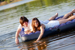 Two on swimming mattress Royalty Free Stock Images