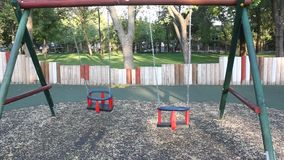 Two swing seats. Swinging at playground stock footage