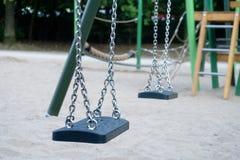 Children Playground - swing in focus stock images