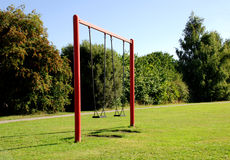 Two swings at the park Royalty Free Stock Photo