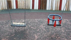 Two swings. In seesaw - retro and modern stock video footage