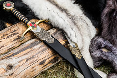 Two swords and some furs Royalty Free Stock Photo