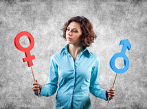 Gender symbols. Two symbols of a different gender in hands of the girl Royalty Free Stock Images