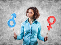 Gender symbols. Two symbols of a different gender in hands of the girl Royalty Free Stock Photography