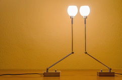two symmetric table lamps Stock Images