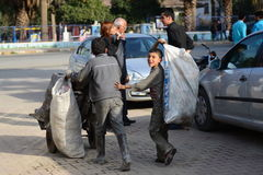 Two syrian refugges. Two boys from Syria working on street in town Kilis in Turkey. They escaped from Syria because of civil war Royalty Free Stock Photography