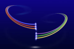 Two systems of multi colored fiber optic cables with light on blue background Royalty Free Stock Photos