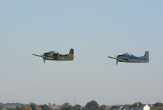 Two T-28 Fennec trainers fly in formation Royalty Free Stock Photography