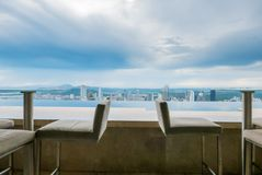Two table with panoramic view over Panama City stock images