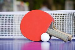 Two table tennis or ping pong rackets and balls Stock Photos