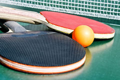 Two table tennis rackets and a ball Stock Photo