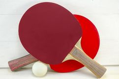 Two table tennis rackets and a ball Royalty Free Stock Images
