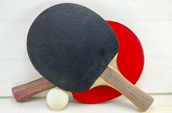 Two table tennis rackets and a ball Stock Image