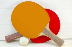 Two table tennis rackets and a ball Royalty Free Stock Photo