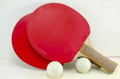 Two table tennis rackets and balls Stock Photography