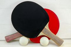 Two table tennis rackets and balls Royalty Free Stock Photography