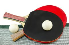 Two table tennis rackets and a net isolated Stock Photos