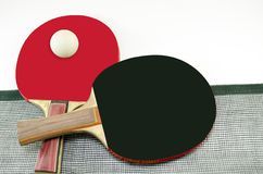 Two table tennis rackets and a net isolated Royalty Free Stock Image