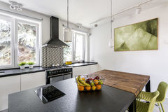 Two tables in bright kitchen royalty free stock photo