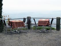 Two tables in the restaurant on the mountain stock photography