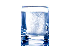 Two tablet in glass of water. Two soluble tablet in glass of water Royalty Free Stock Photos