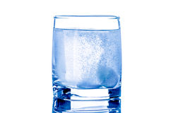 Two tablet in glass of water Stock Images