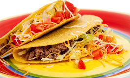 Two tacos on a plate on a white background Royalty Free Stock Photos