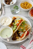Two tacos with sauce on plate Stock Photography
