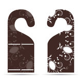 Two tags on the door hanger ornament with brown with white. Two tags on the door hanger with ornament Royalty Free Stock Images