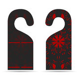 Two tags on the door hanger ornament with dark gray with red. Two tags on the door hanger with ornament Stock Photo