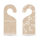 Two tags on the door hanger ornament with light brown and white. Two tags on the door hanger with ornament Royalty Free Stock Image