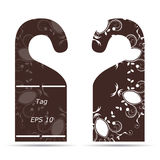 Two tags on the door hanger ornament with a white with brown Royalty Free Stock Images