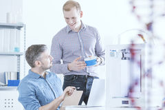 Two talking scientists. In a laboratory with 3D printer Royalty Free Stock Image