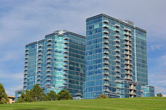 Two Tall Blue Buildings. Two adjacent blue high rise residential skyscrapers in an urban areas Royalty Free Stock Image
