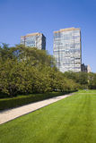 Two tall buildings and a park. Two tall buildings seen from a park stock photos