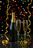 Two tall elegant glasses filled with Golden Champagne Stock Images