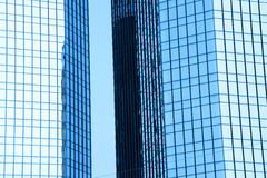 Two tall glass buildings Stock Images