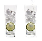 Two tall glasses with ice Royalty Free Stock Image